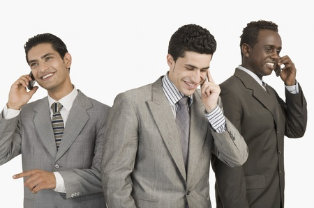 Three businessmen talking on mobile phones Stock Photo - 10166621