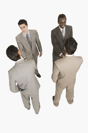 Four businessmen shaking hands Stock Photo - 10124270