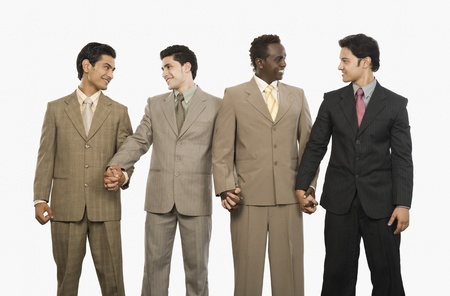 Four businessmen standing with holding hands Stock Photo - 10125086