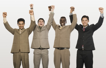 Portrait of four businessmen with arms raised