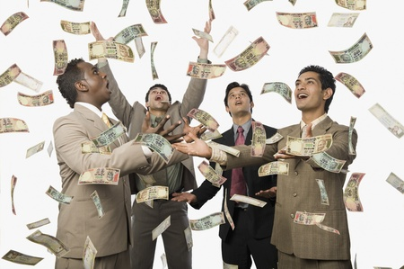 business opportunity: Banknotes falling over four businessmen LANG_EVOIMAGES