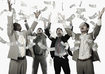 Banknotes falling over four businessmen Stock Photo - 10166533