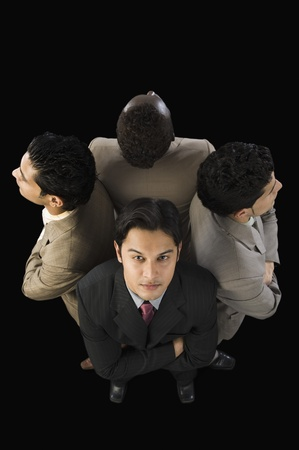 High angle view of four businessmen standing with arms crossed Stock Photo - 10124345