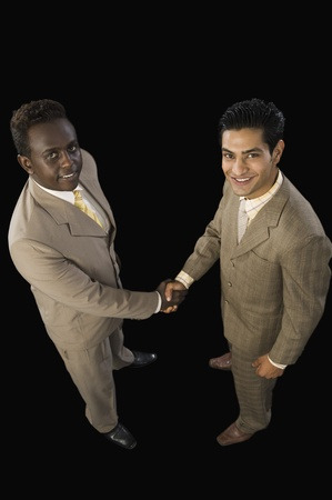 High angle view of two businessmen shaking hands Stock Photo - 10124766