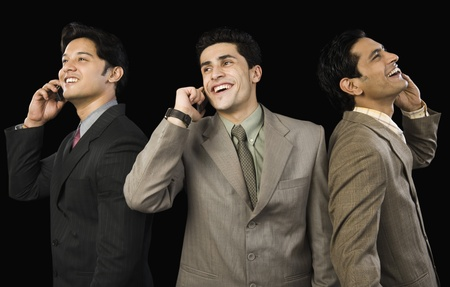 Three businessmen talking on mobile phones Stock Photo - 10166608