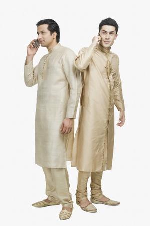 two men talking: Two men talking on mobile phones