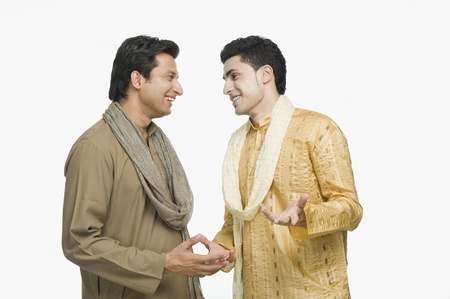 kurta: Two men talking with each other LANG_EVOIMAGES