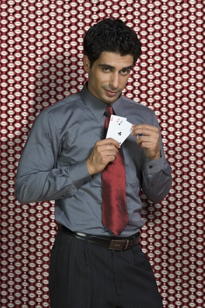 Portrait of a man holding three aces Stock Photo - 10169053
