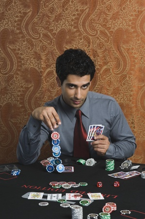 Portrait of a man gambling in a casino Stock Photo - 10169108