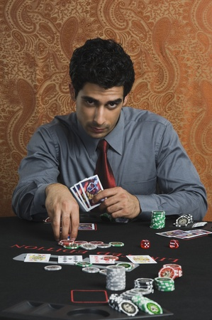 Portrait of a man gambling in a casino Stock Photo - 10169131