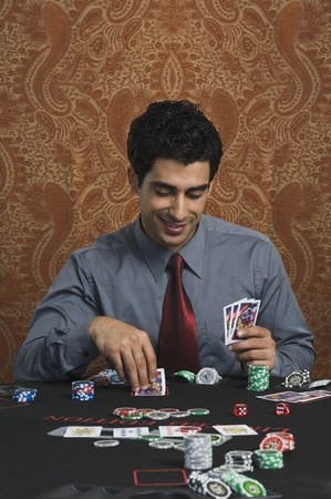casino table: Man at a casino table LANG_EVOIMAGES