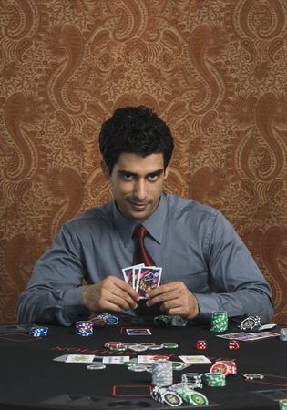 Portrait of a man gambling in a casino Stock Photo - 10169127