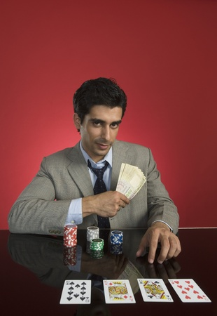 Portrait of a man gambling in a casino Stock Photo - 10169170
