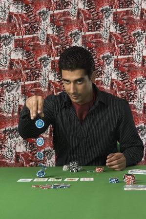 Portrait of a man gambling in a casino Stock Photo - 10169072