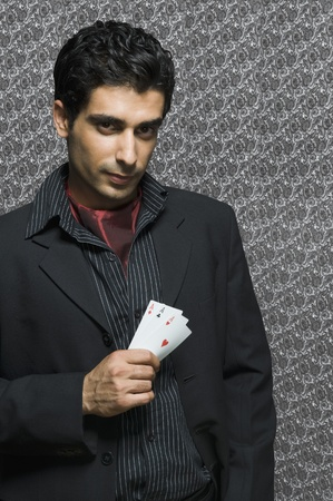 Portrait of a man holding three aces Stock Photo - 10166697