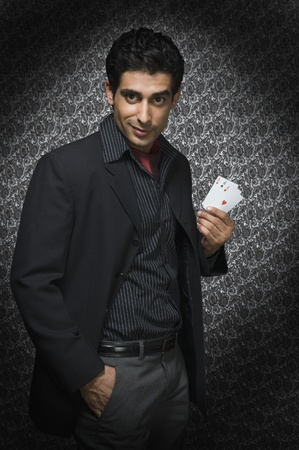 Portrait of a man holding three aces Stock Photo - 10169046
