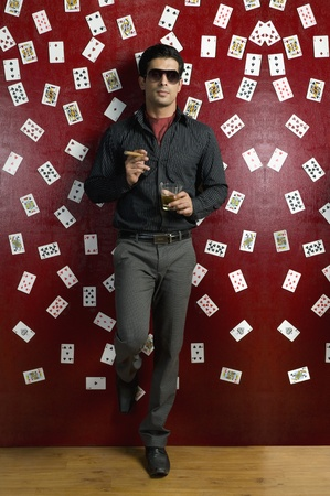 Man drinking and smoking in a casino Stock Photo - 10166692