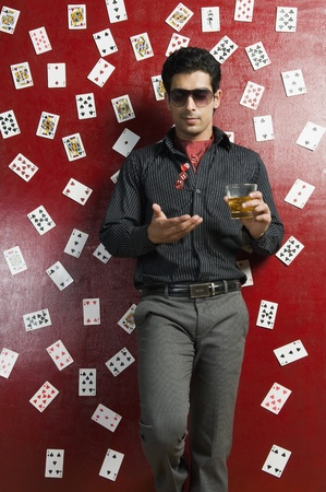 Man drinking whiskey and tossing dices Stock Photo - 10166700