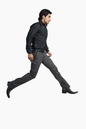Man walking on a white background Stock Photo