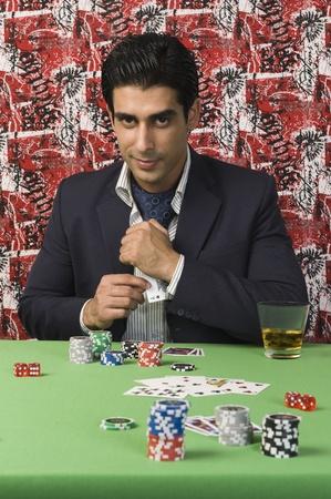 Portrait of a man gambling in a casino Stock Photo - 10166686