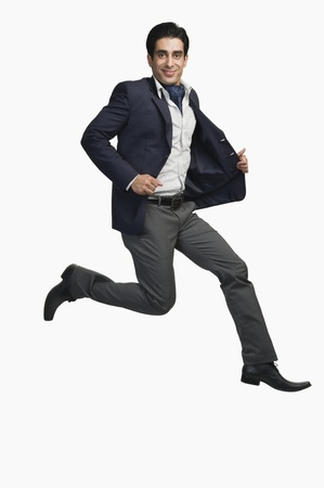 Portrait of a man jumping against a white background Stock Photo - 10125836