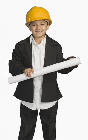Girl dressed as an architect and holding a blueprint