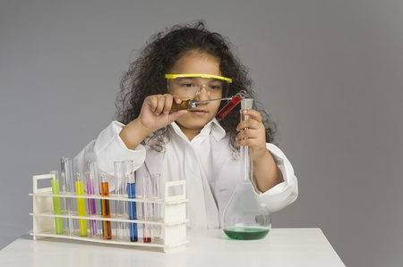 Girl dressed as scientist researching in the laboratory Stock Photo - 10124601