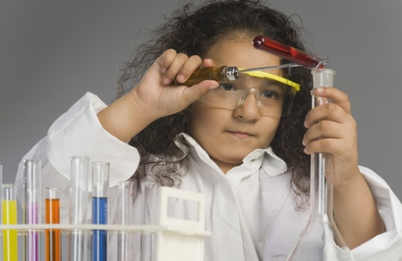 Girl dressed as scientist researching in the laboratory Stock Photo - 10169469