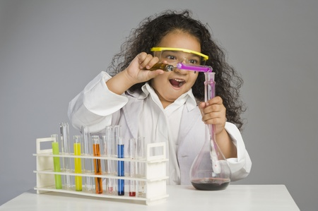 Girl dressed as scientist researching in the laboratory Stock Photo - 10125035
