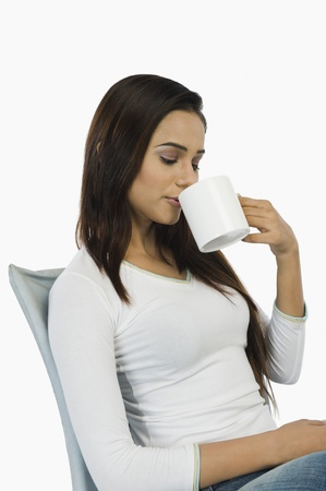 Woman drinking coffee Stock Photo - 10124461