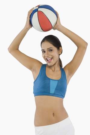 Woman holding a volleyball Stock Photo - 10125509