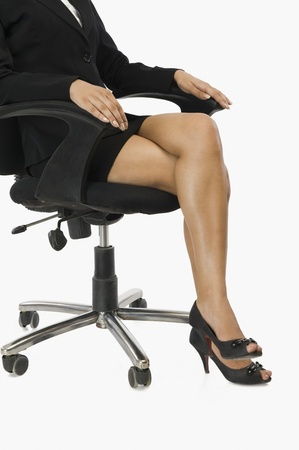 legs crossed: Businesswoman sitting on a chair