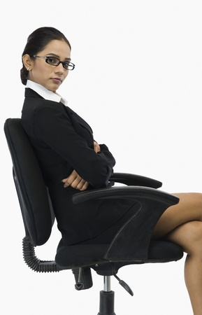legs crossed at knee: Businesswoman sitting on a chair