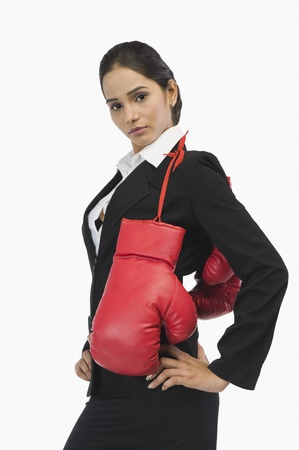 Businesswoman in boxing gloves Stock Photo - 10124132