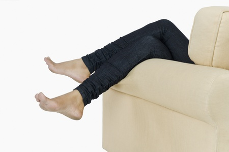 low section view: Low section view of a woman lying on a couch