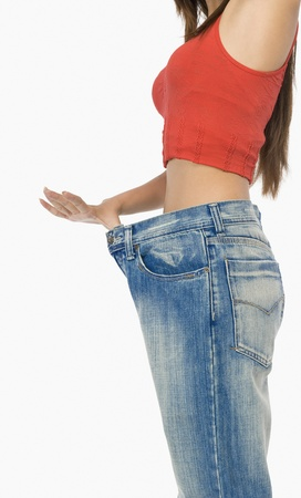 Mid section view of a woman pulling her jeans Stock Photo - 10169106