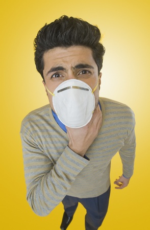 Businessman wearing pollution mask Stock Photo - 10167754