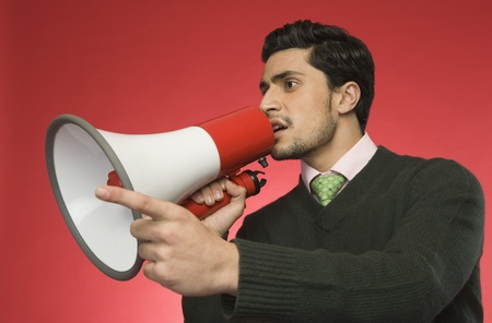 Businessman with a megaphone Stock Photo - 10167631