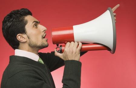 loudspeaker: Businessman with a megaphone