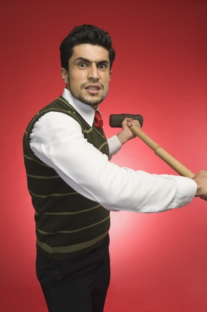 Portrait of a businessman holding a sledgehammer Stock Photo - 10167452