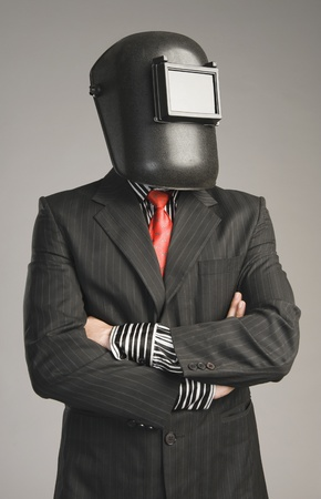 Businessman wearing a welding mask