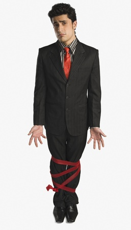 Businessman showing his legs tied up with a ribbon Stock Photo - 10166875