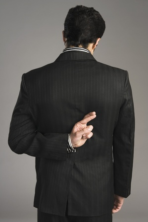 Businessman with fingers crossed behind his back Stock Photo - 10167720
