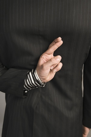 Businessman with fingers crossed behind his back Stock Photo - 10167847