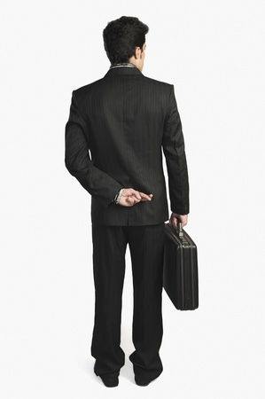 Businessman with fingers crossed behind his back Stock Photo - 10166817