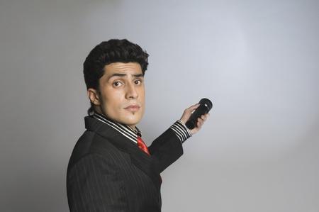 Businessman holding a flashlight Stock Photo - 10167547