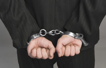 Rear view of a businessman tied up with handcuffs Banco de Imagens