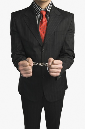 Close-up of a businessman tied up with handcuffs Stock Photo - 10167255