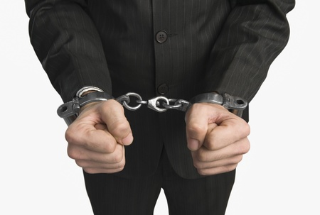 Close-up of a businessman tied up with handcuffs Stock Photo - 10167313