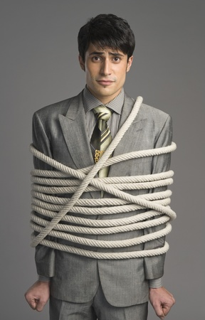 Portrait of a businessman tied up with ropes Stock Photo - 10167906